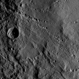 This view from NASA's Dawn spacecraft shows part of the southwestern rim of Yalode Crater on Ceres. Yalode is one of the largest impact basins on Ceres. A great deal of material has slumped down the walls of the crater. a phenomenon called mass wasting.