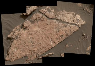 The network of cracks in this Martian rock slab called 'Old Soaker' may have formed from the drying of a mud layer more than 3 billion years ago. The view combines three images taken by NASA's Curiosity Mars rover on Dec. 31, 2016.