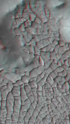 This anaglyph from NASA's Mars Reconnaissance Orbiter shows part of Gordi Dorsum in the Medusae Fossae region of Mars, shows part of an area on Mars where narrow rock ridges, some as tall as a 16-story building.