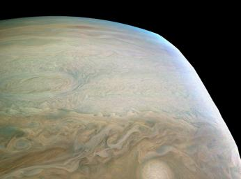 This enhanced color Jupiter image, taken by the JunoCam imager on NASA's Juno spacecraft, showcases several interesting features on the apparent edge (limb) of the planet.