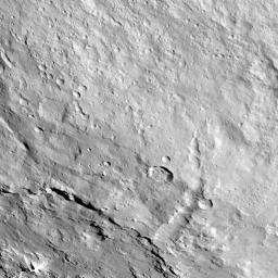 This image from NASA's Dawn spacecraft shows the northeastern rim of Urvara Crater on Ceres at lower left. To the right of the crater, the long, narrow feature that appears to jut out toward the north is called Pongal Catena.