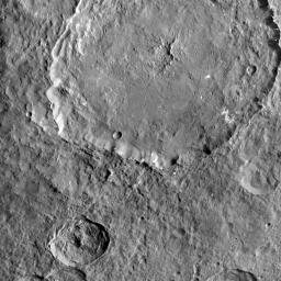 This image from NASA's Dawn spacecraft shows Dantu Crater. The numerous bright spots found across the crater suggest bright material may be just below the surface, exposed through small impacts and landslides.