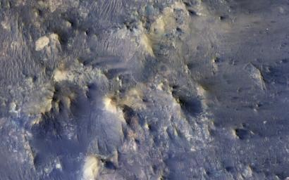 This color composite from NASA's Mars Reconnaissance Orbiter covers a portion of the northern central peak of an unnamed, 20-kilometer crater that contains abundant fragmental bedrock called breccia.