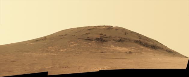 This view NASA's Mars Exploration Rover Opportunity looks back at the southern end of 'Cape Tribulation' from about two football fields' distance away.