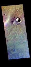 The THEMIS camera contains 5 filters. The data from different filters can be combined in multiple ways to create a false color image. This image from NASA's 2001 Mars Odyssey spacecraft shows several small craters in Aonia Terra.