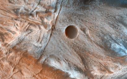 Viscous, lobate flow features are commonly found at the bases of slopes in the mid-latitudes of Mars, and are often associated with gullies, as seen by NASA's Mars Reconnaissance Orbiter.