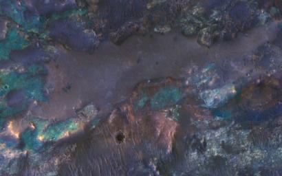 The collision that created Hargraves Crater impacted into diverse bedrock lithologies of ancient Mars; the impact ejecta is a rich mix of rock types with different colors and textures, as seen by NASA's Mars Reconnaissance Orbiter.