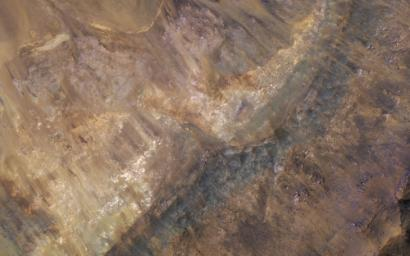 This image from NASA's Mars Reconnaissance Orbiter reveals layers filling a larger crater, perhaps a combination of lava, impact ejecta, and sediments.