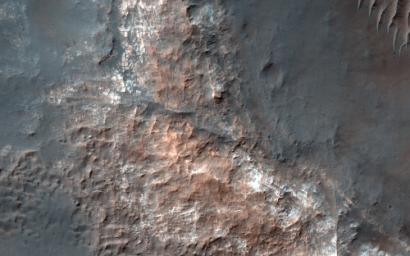This image from NASA's Mars Reconnaissance Orbiter shows Gorgonum Basin, one of several large basins within the Terra Sirenum region of Mars. Each basin has light-toned mounds, many of which contain clays.