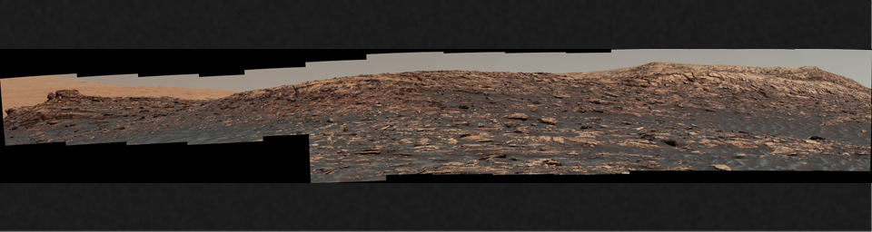 'Vera Rubin Ridge,' a favored destination for NASA's Curiosity Mars rover even before the rover landed in 2012, rises near the rover nearly five years later in this panorama from Curiosity's Mastcam.