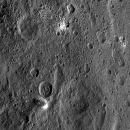 NASA's Dawn spacecraft took this image of Xevioso Crater on Oct. 15, 2015. Xevioso is located in the vicinity of Ahuna Mons, the tall, lonely mountain seen toward the bottom of the picture.