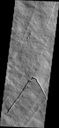 This image from NASA's 2001 Mars Odyssey spacecraft shows part of the southeastern flank of Pavonis Mons. Pavonis Mons is one of the three aligned Tharsis Volcanoes.