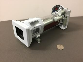 This image shows a 3-D printed model of Mastcam-Z, one of the science cameras on NASA's Mars 2020 rover. Mastcam-Z will include a 3:1 zoom lens.