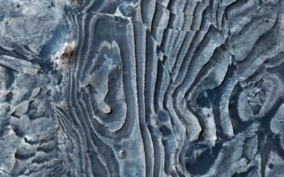 This image from NASA's Mars Reconnaissance Orbiter (MRO) of northern Meridiani Planum shows faults that have disrupted layered deposits.