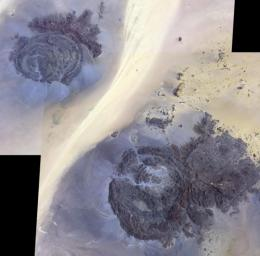 In the far southeast corner of Libya, in the Libyan Desert, lie the uplifted massifs of Jebel Awenat and Jebel Arkenu. Both expose ancient Precambrian rocks. These images from NASA's Terra spacecraft were acquired July 19, 2012, and July 31, 2013.
