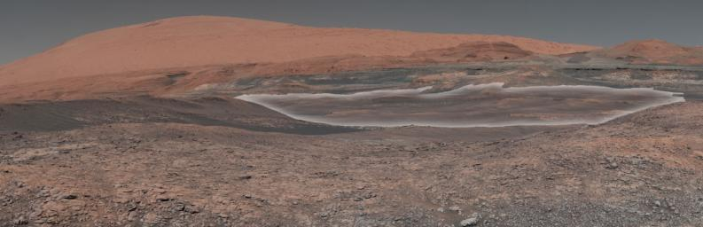 This mosaic taken by NASA's Mars Curiosity rover looks uphill at Mount Sharp. Highlighted is an area in white with clay-bearing rocks that scientists are eager to explore.