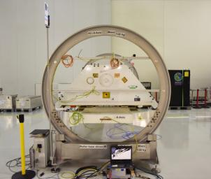One of the two Gravity Recovery and Climate Experiment Follow-On (GRACE-FO) satellites and its turntable fixture at the Astrotech Space Operations processing facility at Vandenberg Air Force Base, California.