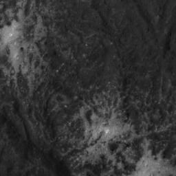 This close-up image of the Vinalia Faculae in Occator Crater on Ceres, obtained by NASA's Dawn spacecraft on June 14, 2018, reveals the intricate pattern between bright and dark material across this flow feature.