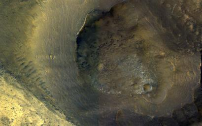 This image from NASA's Mars Reconnaissance Orbiter shows a hill with a central crater. Such features have been interpreted as both mud volcanoes (really a sedimentary structure) and as actual volcanoes (the erupting lava kind).