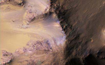 This image from NASA's Mars Reconnaissance Orbiter shows Ganges Chasma in the northeast portion of Valles Marineris. Scattered hills on the canyon floor may be remnants of chaos terrain that formed from collapse of the canyon.