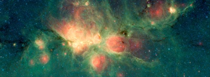 The Cat's Paw Nebula, imaged here by NASA's Spitzer Space Telescope, is a star-forming region that lies inside the Milky Way Galaxy.