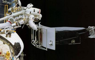 This image of NASA's Hubble Space Telescope shows Astronaut Jeffrey Hoffman removing the Wide Field and Planetary Camera 1 (WFPC 1) during the first Hubble servicing mission (SM1), which took place in December, 1993.