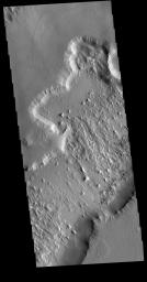 This image from NASA's Mars Odyssey shows the northern end of Gordii Dorsum, where the surface slopes down into southern Amazonis Planitia. Dark slope streaks are visible on the lower cliff face.