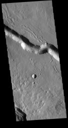 This image from NASA's Mars Odyssey shows a section of one of the many channel forms found on the northwestern side of the Elysium Mons volcanic complex. The channel features are thought to have both a tectonic and volcanic origin.