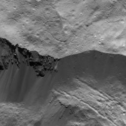 This image of a wall on Occator Crater on Ceres was obtained by NASA's Dawn spacecraft on July 5, 2018 from an altitude of about 26 miles (43 kilometers).
