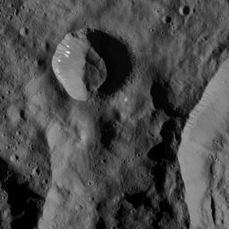 This image of bright spots in a small crater on Ceres was obtained by NASA's Dawn spacecraft on July 1, 2018 from an altitude of about 179 miles (288 kilometers).