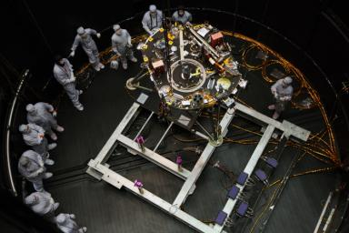 Engineers at Lockheed Martin Space, Denver, Colorado, prepare NASA's InSight lander for testing in a thermal vacuum chamber several months before launch.