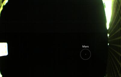 The is the first image of Mars captured by one of NASA's Mars Cube One (MarCO) CubeSats showing both the CubeSat's unfolded high-gain antenna at right and Mars just below, acquired by MarCO-B on October 2, 2018.