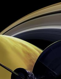 This illustration imagines the view from NASA's Cassini spacecraft during one of its final dives between Saturn and its innermost rings, as part of the mission's Grand Finale.