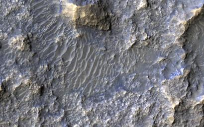 This image acquired on May 22, 2018 by NASA's Mars Reconnaissance Orbiter, shows a 30-kilometer diameter crater, filled-in with materials that created bedrock, and through subsequent erosion, wind-driven particles.