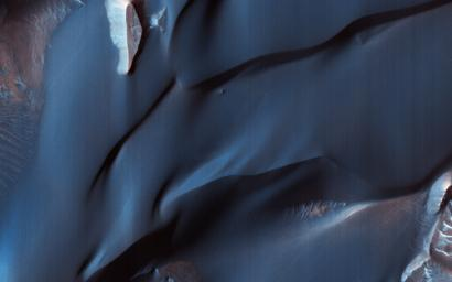 This image acquired on May 16, 2018 by NASA's Mars Reconnaissance Orbiter, shows sand dunes in Melas Chasma, located within the Valles Marineris canyon system.