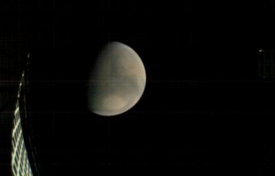 On Nov. 26, 2018, MarCO-B, one of NASA's Mars Cube One (MarCO) CubeSats, took this image of Mars from about 11,300 miles (18,200 kilometers) away shortly before NASA's InSight spacecraft landed on Mars.
