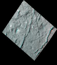 This stereo view, called an anaglyph, of cracks in the floor of Occator Crater on Ceres was obtained by NASA's Dawn spacecraft from an altitude of about 22 miles (35 kilometers).