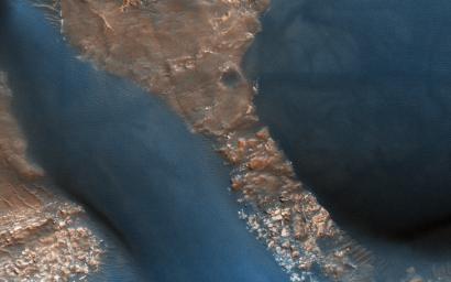 This image acquired on March 29, 2011 by NASA's Mars Reconnaissance Orbiter, shows dunes with ripples on their upwind slopes and dark streaks on their downwind slopes.