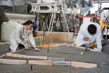 Engineers measure their test lander's 'workspace' -- the terrain where scientists want to set InSight's instruments -- at NASA's Jet Propulsion Laboratory in Pasadena, California.