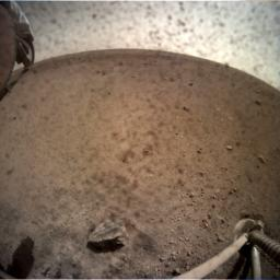 NASA's InSight spacecraft flipped open the lens cover on its Instrument Context Camera (ICC) on Nov. 30, 2018, and captured this view of Mars.