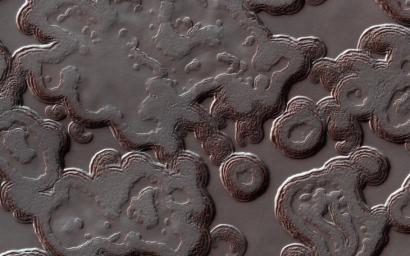 This image acquired on August 1, 2018 by NASA's Mars Reconnaissance Orbiter, shows the Martian south polar cap full of pits that make it look like Swiss cheese.