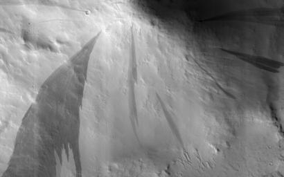 This image acquired on September 30, 2018 by NASA's Mars Reconnaissance Orbiter, shows slope streaks which are small avalanches of dust and sand from the hillsides.