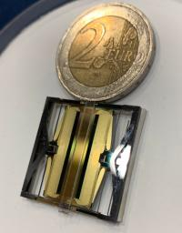 This image shows a copy of one of the sensors on NASA InSight's seismometer, compared to a 2-euro coin (about 1 inch wide).