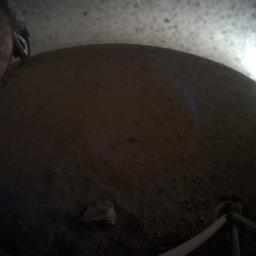 A fish-eye view of NASA's InSight lander deploying its first instrument onto the surface of Mars, taken by the spacecraft's Instrument Context Camera (ICC) on Dec. 19, 2018.