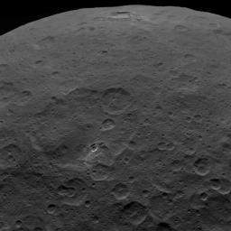 This image shows Haulani Crater and its bright ejecta near the limb of Ceres and Oxo Crater, as obtained by NASA's Dawn spacecraft on September 1, 2018 from an altitude of about 2075 miles (3340 kilometers).