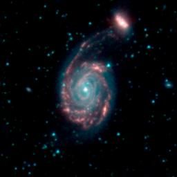 This image, by NASA's Spitzer Space Telescope, shows the merger of two galaxies, known as NGC 7752 (larger) and NGC 7753 (smaller), also collectively called Arp86.