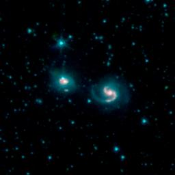 This image, by NASA's Spitzer Space Telescope, shows the merger of two galaxies, known as NGC 6786 (right) and UGC 11415 (left), also collectively called VII Zw 96.