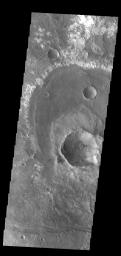 This image from NASA's Mars Odyssey shows a group of craters in Terra Sirenum. The apparent youngest one is the center crater with the scalloped rim.