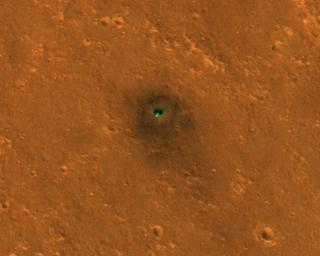 NASA's InSight spacecraft and its recently deployed Wind and Thermal Shield were imaged on Feb. 4, 2019, by the HiRISE camera aboard NASA's Mars Reconnaissance Orbiter.