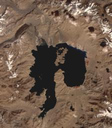 NASA's Terra spacecraft shows Lake Karakul in northeast Tajikistan, a hypersaline lake with no external drainage, receiving less than 3 cm precipitation per year.